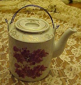 Vintage Asian style porcelain teapot with red florals