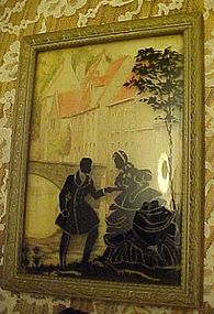 Courting couple framed silhouette convex glass