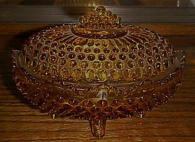 Fenton amber hobnail oval covered candy dish