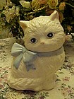 White persian cat cookie jar with blue bow