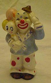 Vintage clown figurine with anthropomorphic balloons