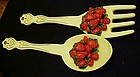 Large wall  fork and spoon heaped with red strawberries