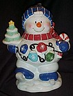 Ice skating snowman cookie jar, tree, mittens, cane