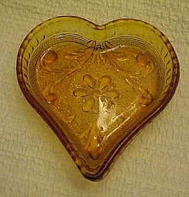 Tiara sandwich amber  glass heart nut dish  by Indiana