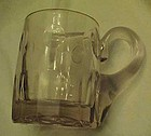Antique blown glass beer mug turning purple