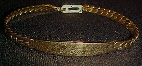 Pretty  gold tone Id bracelet  by Spiedel engraved MOM
