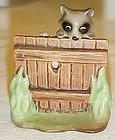 Hagen Renaker Raccoon climbing fence miniature figurine