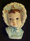 Baby girl in blue bonnet small head vase spaghetti trim