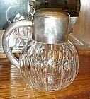 Heavy cut glass crystal water pitcher with silver plate