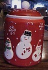 Red Hallmark snowmen cookie jar with snowflakes