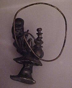 Pewter Genie man smoking a hookah figurine on mushroom