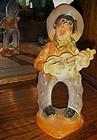 Vintage chalk carnival bow legged cowboy figurine