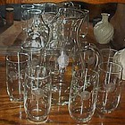 Hand blown pitcher and 8 glasses with cut rose pattern