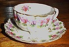 Vintage three toed hand painted floral  cup saucer set