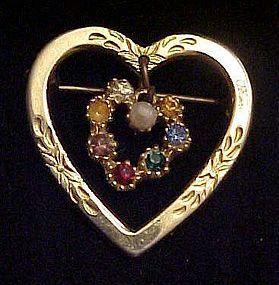 Gold tone heart pin with rhinestone dangle heart center