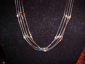 Four chain strand  necklace with semi precious beads