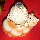Ceramic kitty with rotating ball  of yarn musical