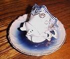 Antique 4 leg flow blue demi teacup and saucer