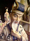 Seymour Mann Collectible Asian Man sitting figurine 8.25""