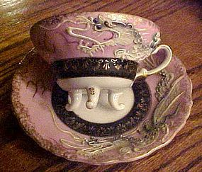 Fancy vintage dragon ware three legged cup and saucer set pink & black