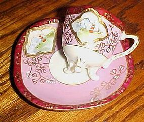 Fancy vintage demitasse cup and saucer with three legs