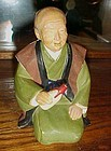 Vintage Hakata Urasaki old man with bottle figurine