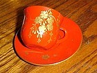 Occupied Japan Lacquer tea cup and saucer flowering vines red and gold
