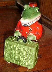 Alligator and luggage go with salt and pepper shakers
