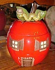 Heavy ceramic apple house cookie jar with worm on top 1976
