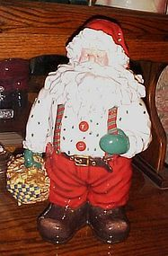 Santa Claus with basket of gingerbread men cookies, cookie jar