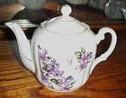 Lovely vintage porcelain teapot with violets