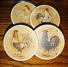 Set of assorted ceramic rooster coasters in holder