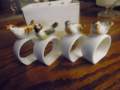 Set of 4 figural porcelain bird napkin rings from House of Global Art