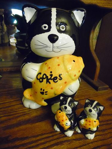 Black & white kitty cat holding fish cookie jar and matching shakers