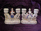 Occupied Japan  figural pair of double candleholders