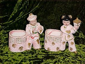 Asian boy and girl figural planter