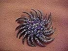 Twisting starburst purple aurora rhinestone pin
