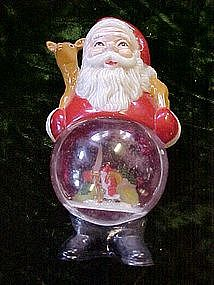 Vintage Santa Claus with snow globe tummy