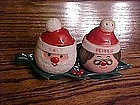 Mr and Mrs. Claus salt and pepper shakers on tray