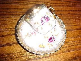 Antique Dresden demitasse cup and saucer, roses
