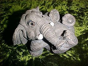 Frolicking elephant figurine with glass eyes