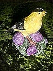 American Goldfinch bird figurine on thistles
