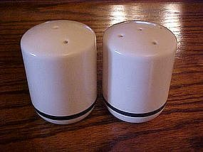 Stoneware shakers with navy blue band trim