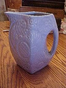 Old Niloak  pitcher , embossed floral, blue glaze