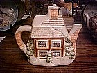 Snow covered house,  ceramic tea pot