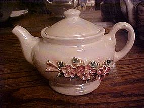 Ceramic lustre teapot with applied flowers