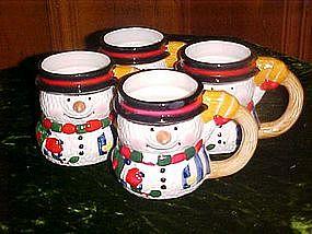 Four ceramic snowman mugs, by Carson ceramics