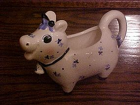 Josef Originals cow creamer ,with calico flowers