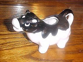Black and white cow cream pitcher