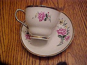 Rose pattern tea cup with matching saucer